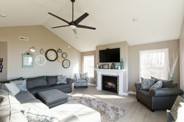 Living Room With Cathedral Ceiling and Fan